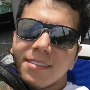 Eduardo Florez Headshot 6 of 10