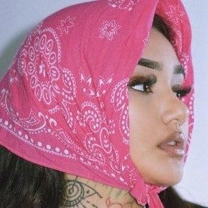 Mulan Vuitton Headshot 2 of 10