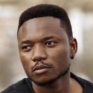 Petit Afro Headshot 3 of 10