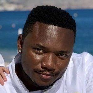 Petit Afro Headshot 7 of 10